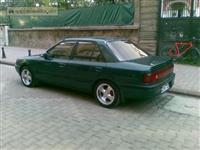 Mazda 323 sedan polovni delovi