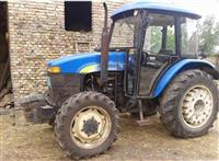 Traktor New Holland SNH704