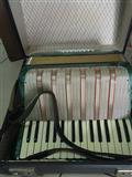 Decja harmonika Melodija pionir sa koferom