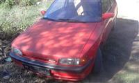 Mazda 323 -levi far